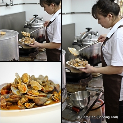 The Chinese Chef stir-frying the clams with deft hands.