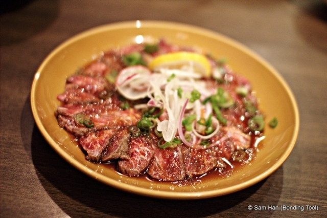 is a dish of raw meat (such as beef, veal, venison, salmon or tuna), thinly sliced or pounded thin and served mainly as an appetizer.