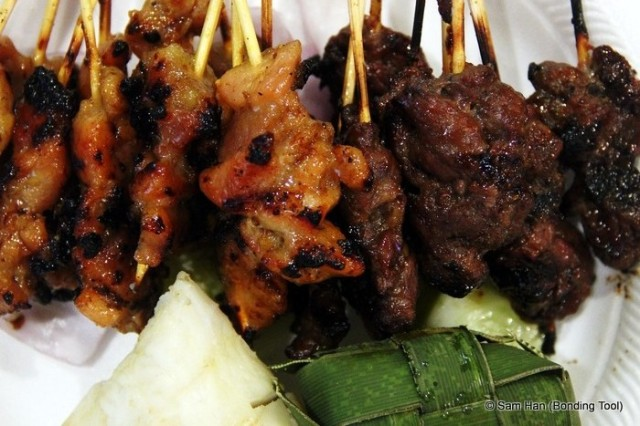 Malay style satay - mutton and chicken with ketupat (compressed rice cakes).