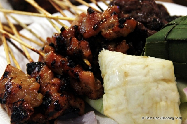 Satay - bammboo skewered grilled meats served with ketupat (compressed rice).