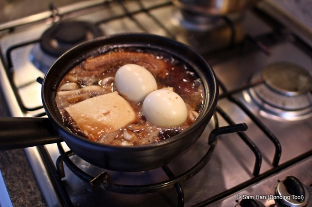 Add prepared tofu and hard-boiled eggs when the water comes to the boil again.
