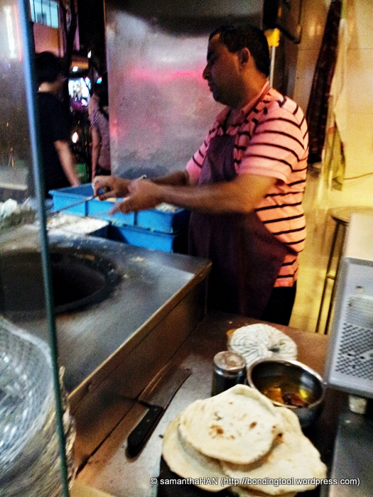 This man actually posed  with a roti and smiled for me but his action was too fast for my Samsung not so smart phone :(