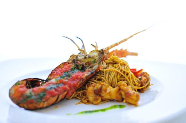 Bonta's signature dish - Home-Made Angel Hair with live lobster, peperoncino, Italian extra virgin olive oil, basil and fresh tomato sauce.