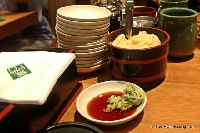 Shoyu with wasabi (Japanese horseradish) and pickled ginger.