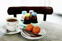 Typical traditional Singaporean breakfast of soft-boiled eggs and kopi.