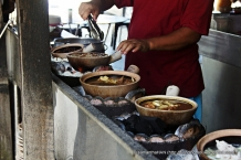 They start to heat up your orders over charcoals - a rare sight in Singapore.