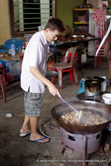 Chef cooking Wild Boar Stew in Desaru, Malaysia.