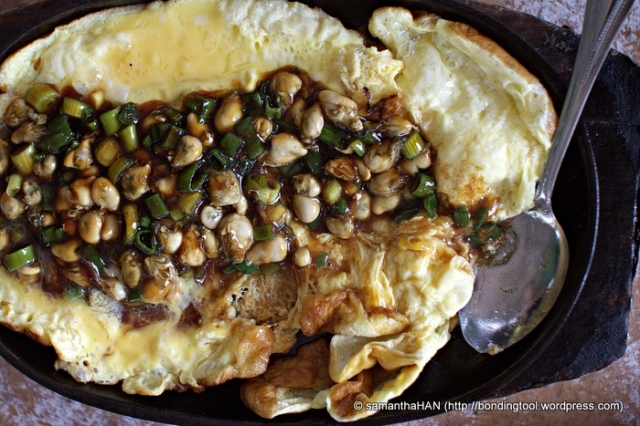 Fluffy Omelet with tiny pearls of Oysters in hotplate Malaysian style.