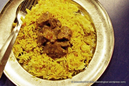Mutton Curry on a bed of Biryani.