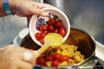 Add ripened but firm cherry tomatoes into the pot and stir to mix for a couple of minutes.