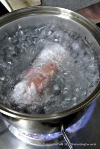 Dunk the rolled and sealed meat parcel into a pot of boiling water and fast boil till it is 80% cooked, about 20 minutes.