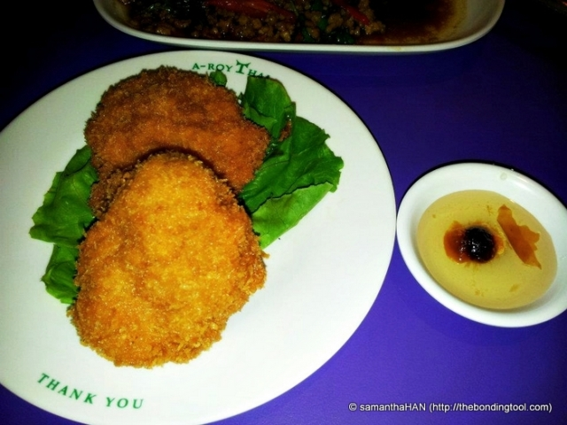 Thai Prawn Cakes with dipping sauce - round objects.