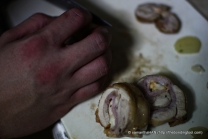 Cut the chicken roulade into thick coins.