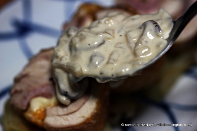 Scoop spoonfuls of mushroom cream sauce over the chicken coins.