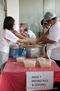 Seasoned rice were scooped into smaller portions and delivered to the wrapping stations.