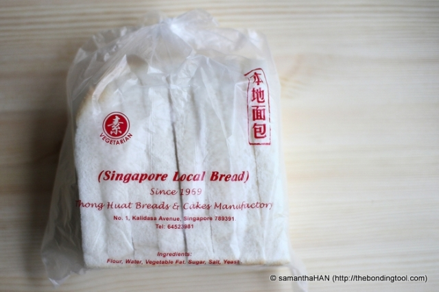 Singapore Local Bread is baked open top. The dark crust are sliced off and hence the shape and colour.