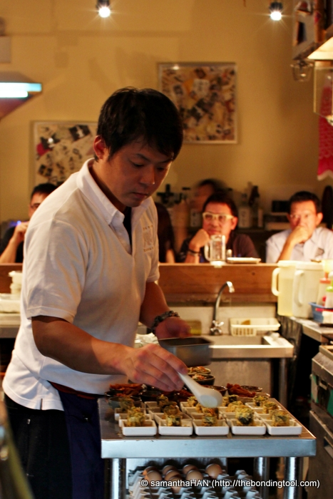 Chef Yamashita Teppei, also the owner, preparing our second course.