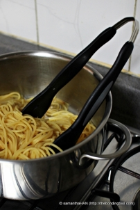 Drain Pasta leaving some of the boiling liquid behind.