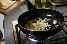 In a pan, add Olive Oil and sauté the Garlic and Chillies for a few seconds.