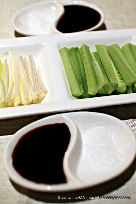 """Scallions and Cucumber sticks are the usual """"garnishing"""" together with the Sweet Bean Paste. The sugar is for the crispy """"backside"""" skin, remember?"""
