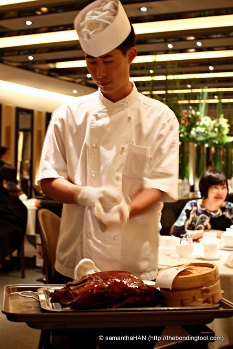 Chef from Beijing preparing to slice the Peking Duck in front of our eyes.