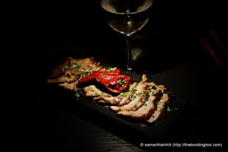 Secreto Iberico , Burnt Spring Onions - Sliced pork pressa served pink with charred spring onions.