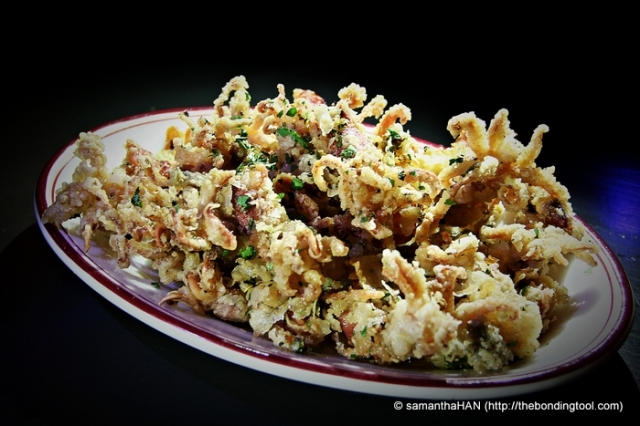 Chipirones - Deep fried baby squid, serves crispy with chilli flakes.