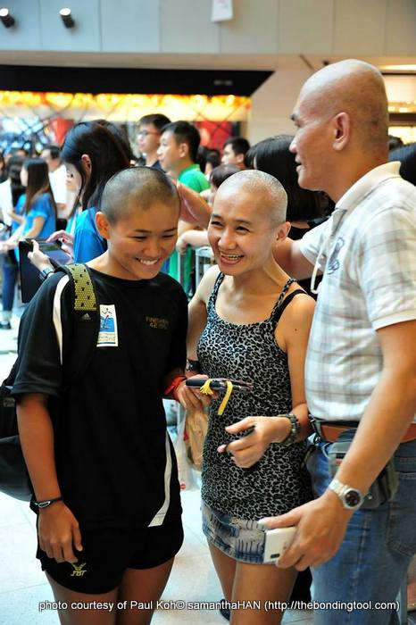Let's go bald together - Charity is a family affair for this trio.