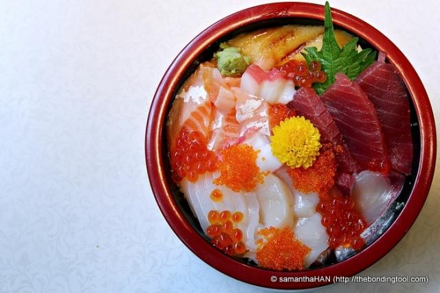 Chirashizushi is scattered sushi served artfully on rice.