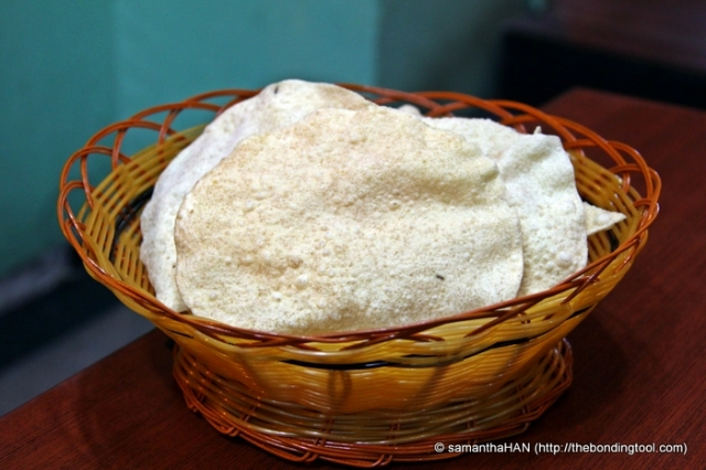 Papadam, is a thin, crisp disc-shaped Indian food typically based on a seasoned dough made from black gram, fried or cooked with dry heat. Flours made from other sources such as lentils, chickpeas, rice, or potato, can be used. Info: Wikipedia
