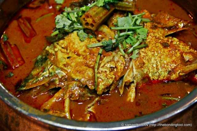 Fish Head Curry - Iconic Singapore dish, invented by Indians (specifically one Mr. Marian Jacob Gomez, from Kerala) for the Chinese palate which values textures. Not found in India. Info: Wikipedia Fish Head Curry small S$22