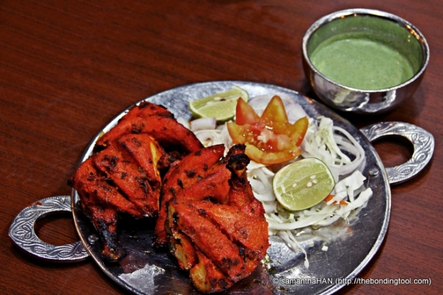 Tandoori chicken is a popular Indian dish consisting of roasted chicken prepared with yogurt and spice mixture tandoori masala. The name comes from the type of cylindrical clay oven, a tandoor, in which the dish is traditionally prepared. Info: Wikipedia Half a bird cost S$12. Served with Mint dipping sauce.
