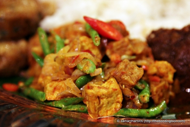 Sambal Goreng - usually tempeh (fermented soya bean cake), taukwa (firm tofu), long beans or French beans, and spices. Sometimes, prawns and ox liver is used too but I did not detect any here.