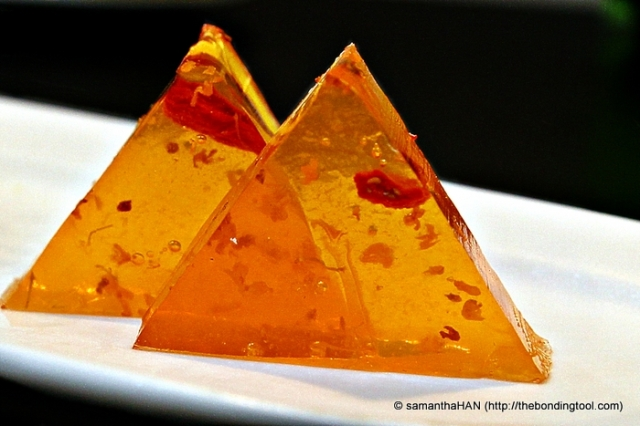 Osmanthus Jelly 桂花糕 - this refreshing and delicious dessert and half a mango fruit was given gratis to us tonight.