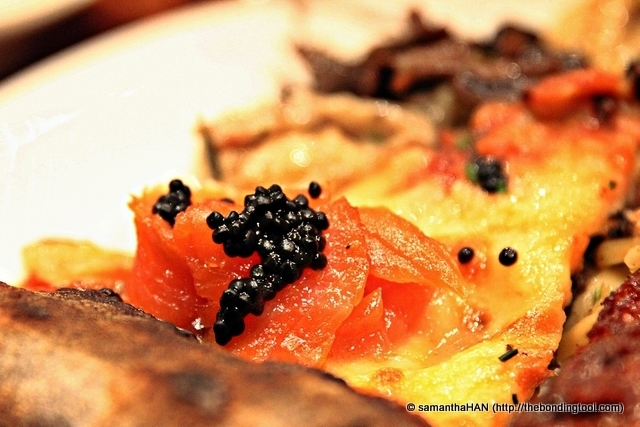 The pizza was not burnt but the charred look was because the dough was Squid Ink (famous here) with Smoked Salmon and Caviar. Such ostentatious fast food!