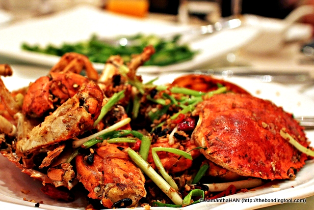 "Spicy Crab Hong Kong Style. The name is Pei Fung Tong Chau Hai, literally ""Shelter from wind pavillion stir-fry crab"". Lol... Hope I got this right. Pei Fung Tong is a place in Hong Kong."