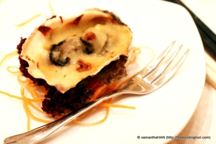 Oyster with creamy cheese sauce.