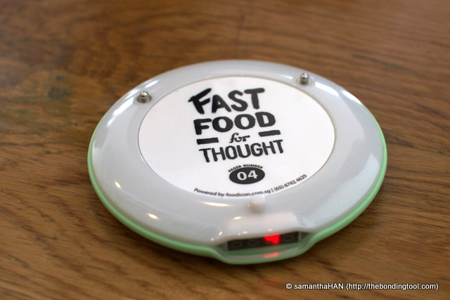 Once the ring around this gadget lights up, food is ready and you'll have to go pick them up at the counter.