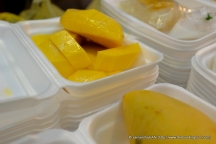 Thai Mango and Glutinous Rice dessert for sale at a roadside stall.