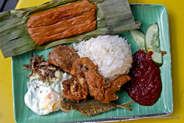 Nasi Lemak is a rice dish made from cooking rice in coconut milk (instead of water) and pandan leaves, serving it with a variety of dishes.