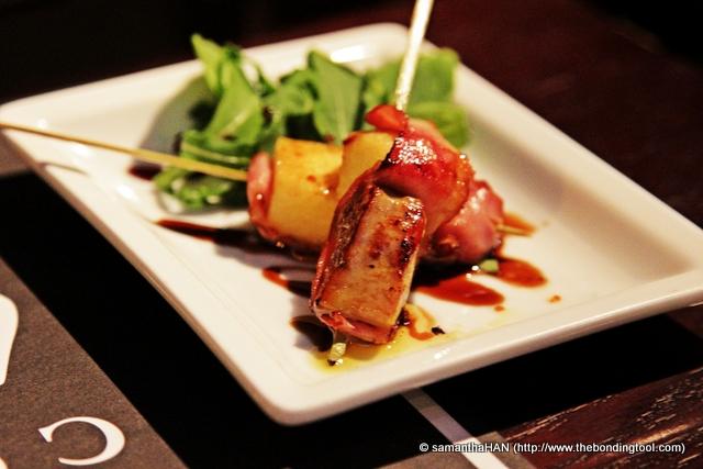 Foie Gras Skewer. Panfried foie gras, crispy duck magret and melted apple.