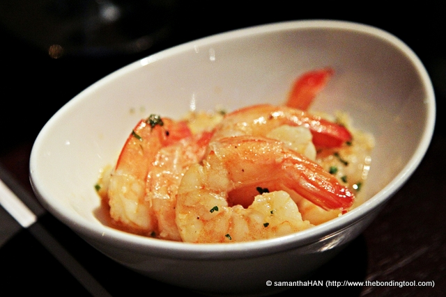 Olive Oil and Garlic marinated Shrimps tossed in pan.