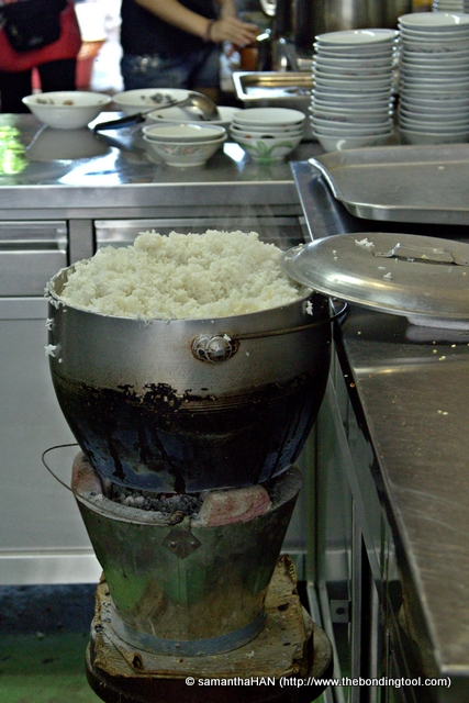 Rice - cooked and kept warm by regulating the heat of charcoal.