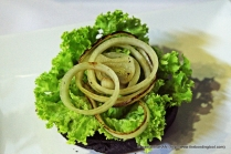 Lettuce and caramelised onion rings. Spritz some chilli sauce later.