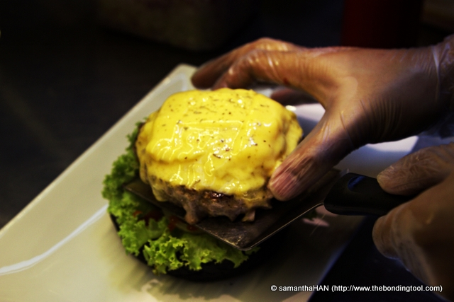 Gently transfer the cooked patty onto the bun.
