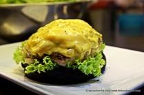 """Nestle the burger onto the """"vegetable plot""""."""