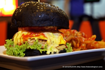 6-inch Volcano Cheesy Burger served with Curly Fries.