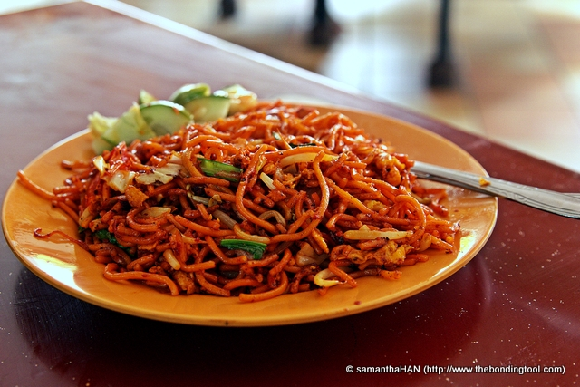 Indian Mee Goreng. Indian style of fried noodles usually has minced mutton and served with a side of cucumbers.