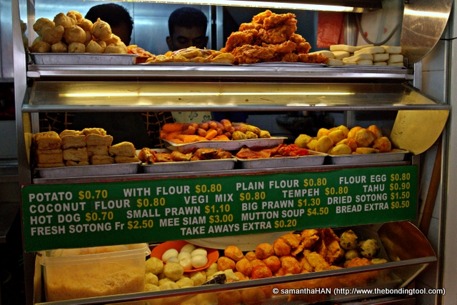 These are ingredients to make Indian Rojak. You choose the items you want and they will be deep-fried or heated up and served with orangey-looking spicy peanut sauce that is different from the satay peanut sauce. The rice vermicelli (in tupperware) and hard boiled eggs on left at the bottom shelf goes into the making of Mee Siam.