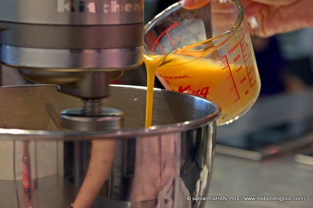 Add eggs one at a time. Chef Jackie prefers to have her eggs beaten in a glass beaker for easier handling.